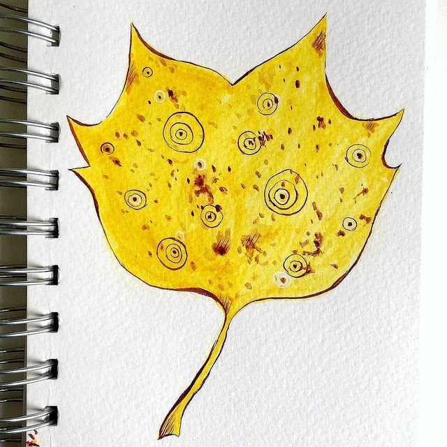 Drawing of a fancy yellow leaf with abstract circle elements