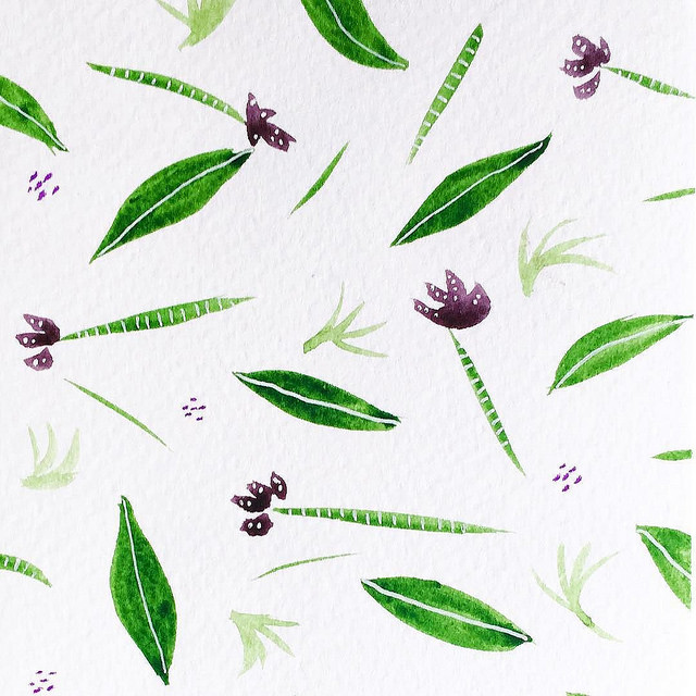 Fun pattern of small green leaves and flowers with purple petals