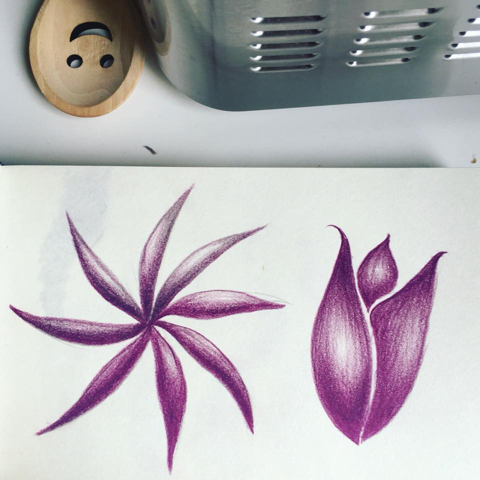 Abstract flowers drawn with purple pencil