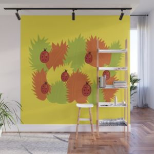 Autumn leaves and ladybugs wall mural at Society6