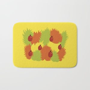 Autumn leaves and ladybugs bathmat at Society6