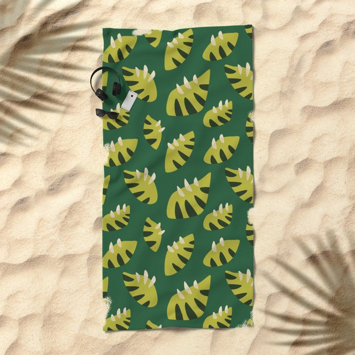 beach towel with a green leaf pattern
